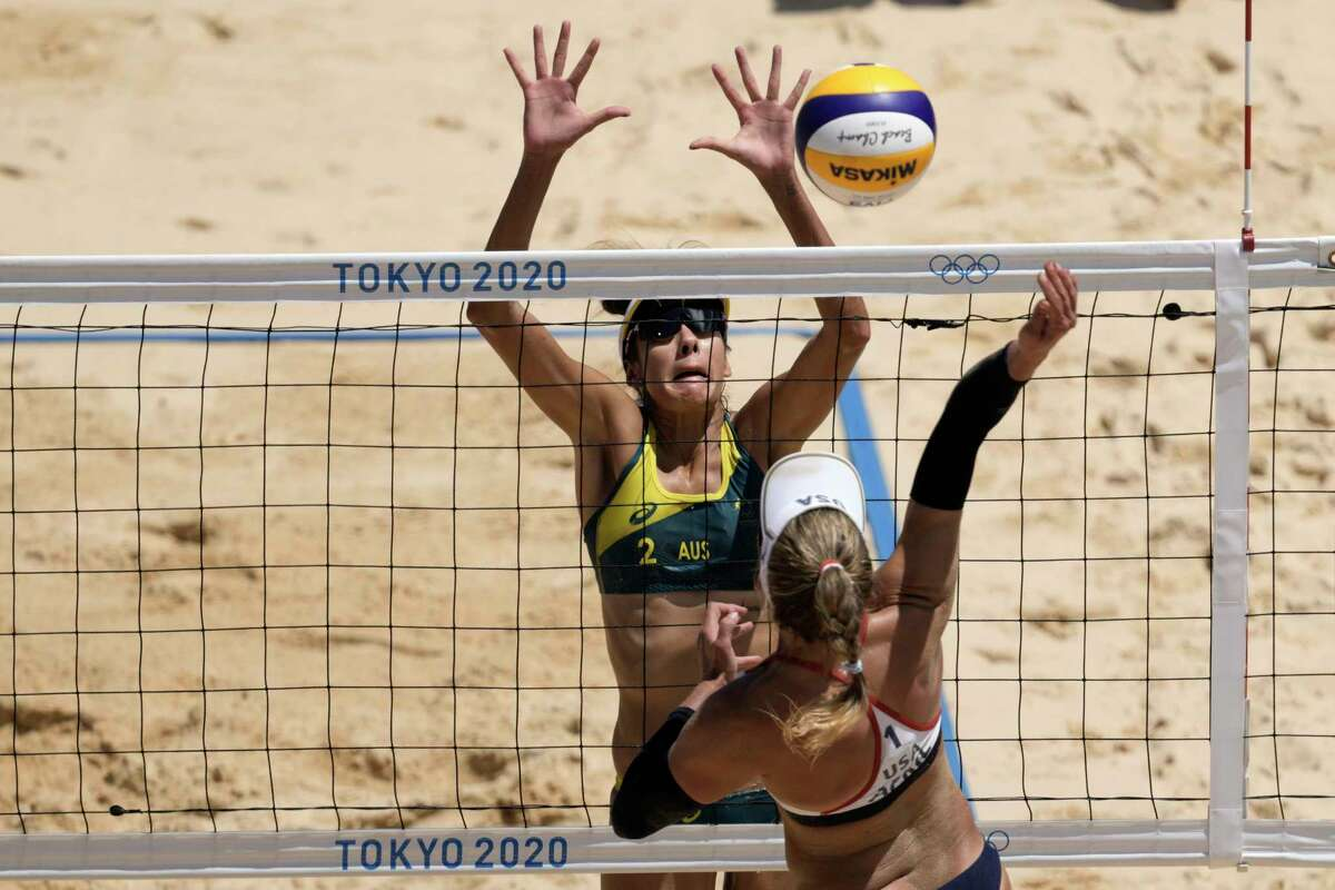 April Ross, right, of the United States, takes a shot as Mariafe Artacho del Solar, of Australia, defends during a women's beach volleyball Gold Medal match at the 2020 Summer Olympics, Friday, Aug. 6, 2021, in Tokyo, Japan.