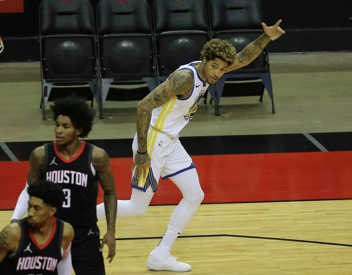 Golden State Warriors guard Kelly Oubre Jr. (12) celebrates his three point basket during the first quarter of the NBA game Wednesday, March 17, 2021, at Toyota Center in Houston.