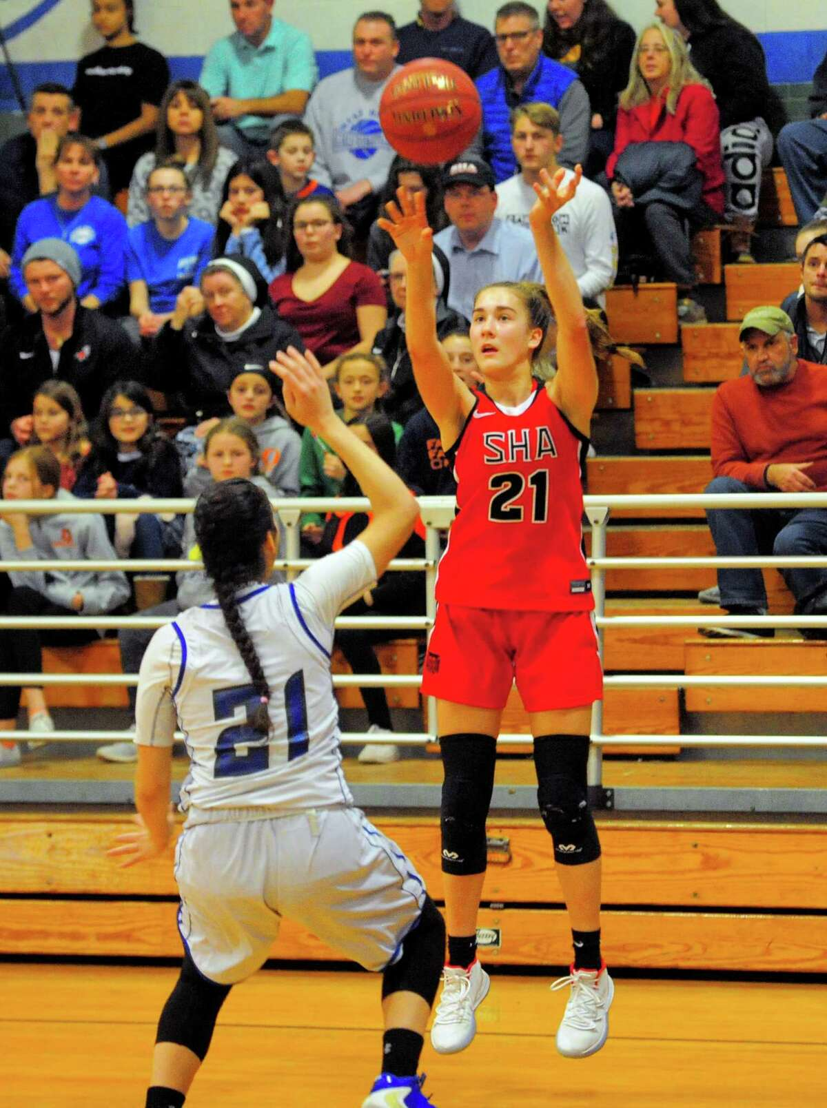 Sacred Heart Academy's Rosa Rizzitelli (21) releases a three-pointer during girls basketball action against West Haven in West Haven, Conn., on Friday Jan. 10, 2020.