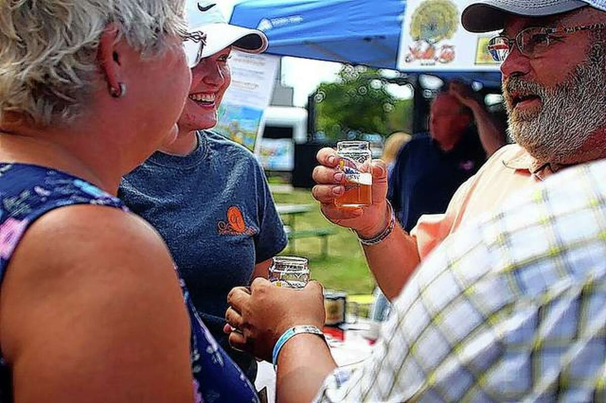 Participants in Jacksonville Main Street's 2019 Craft Brew Festival sample craft beers.