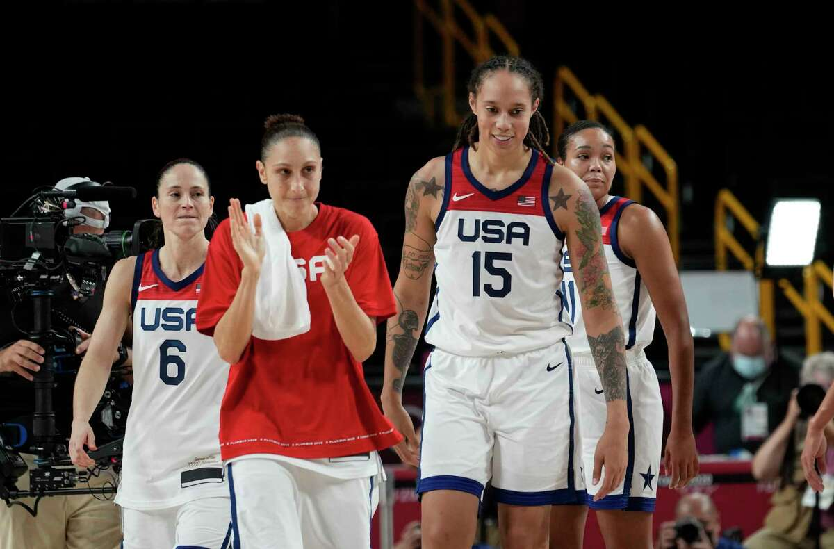 United States' players celebrate their win as they walk up the court during the women's basketball semifinal game against Serbia at the 2020 Summer Olympics, Friday, Aug. 6, 2021, in Saitama, Japan. (AP Photo/Eric Gay)