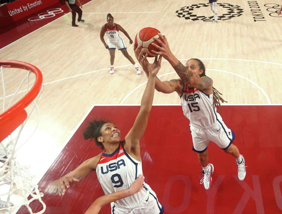 SAITAMA, JAPAN - AUGUST 06: Brittney Griner #15 and A'Ja Wilson #9 of Team United States go up for a rebound against Team Serbia during the first half of a Women's Basketball Semifinals game on day fourteen of the Tokyo 2020 Olympic Games at Saitama Super Arena on August 06, 2021 in Saitama, Japan. (Photo by Gregory Shamus/Getty Images)
