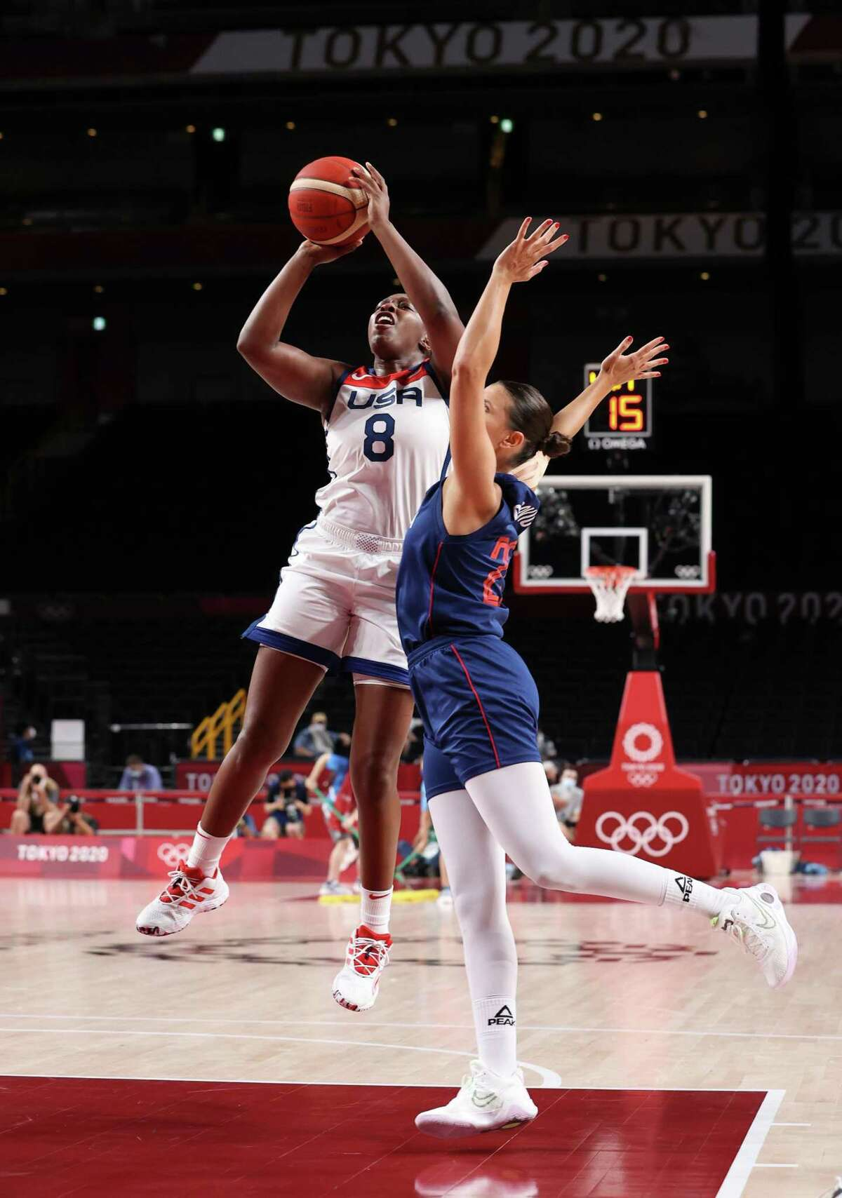 SAITAMA, JAPAN - AUGUST 06: Chelsea Gray #8 of Team United States shoots against Ana Dabovic #23 of Team Serbia during the first half of a Women's Basketball Semifinals game on day fourteen of the Tokyo 2020 Olympic Games at Saitama Super Arena on August 06, 2021 in Saitama, Japan. (Photo by Gregory Shamus/Getty Images)