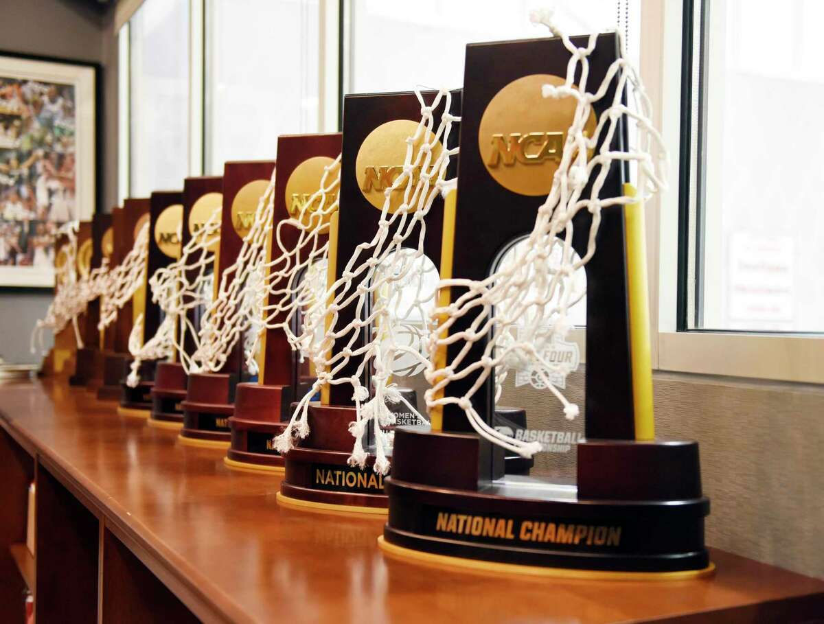 UConn women's basketball coach Geno Auriemma's 11 national championship trophies are displayed in his office at the Werth Family UConn Basketball Champions Center on the UConn main campus in Storrs, Conn., June 14, 2021.