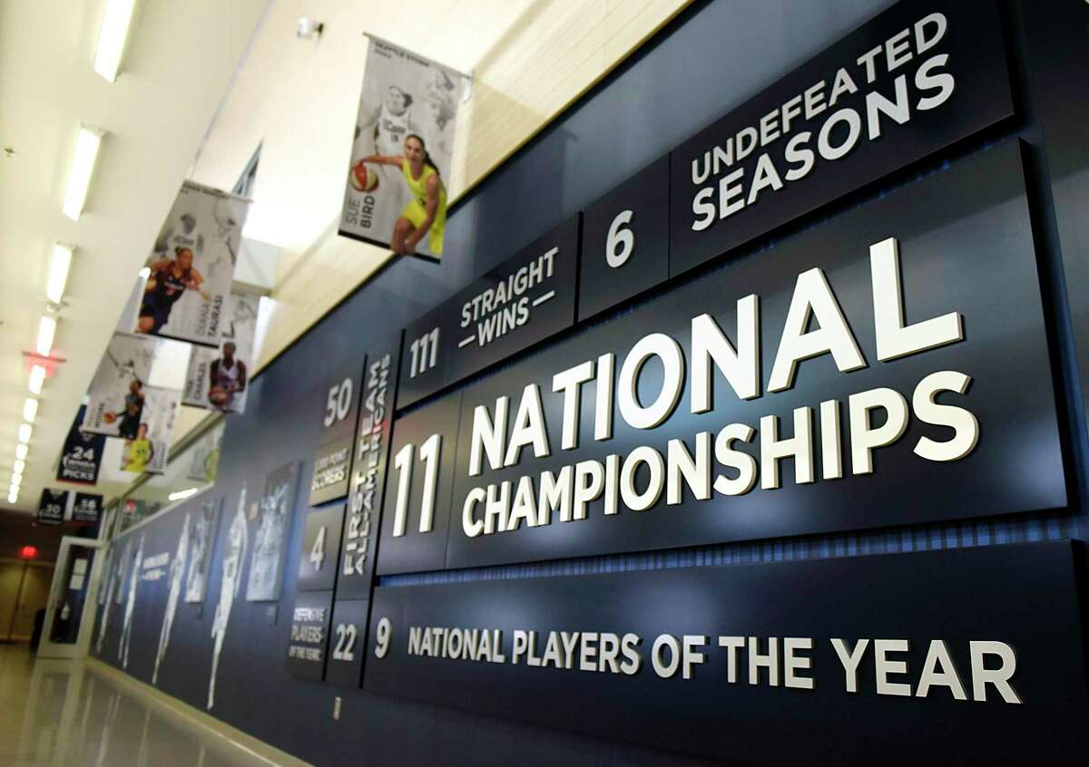 The hallway highlights the accolades of the women's basketball program at the women's basketball practice facility in the Werth Family UConn Basketball Champions Center on the UConn main campus in Storrs, Conn., Monday, June 14, 2021.