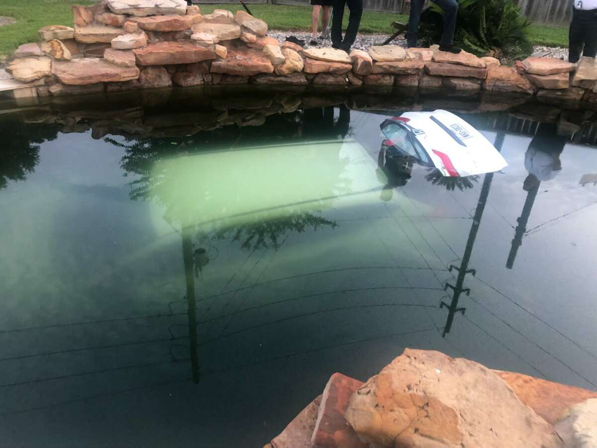A car ended up submerged in a backyard pool early Friday during a Harris County Sheriff's Office pursuit. One suspect was arrested and the other fled on foot.