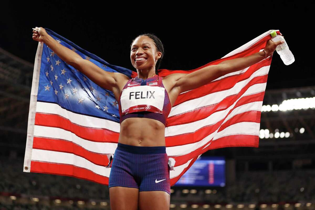 Allyson Felix celebrates her bronze medal in the women's 400 meters. It was the 10th medal of her Olympic career.