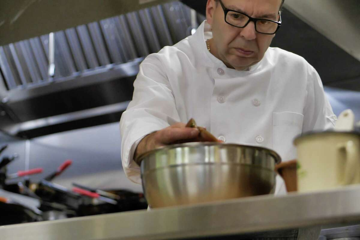 Chef Larry Schepici works in the kitchen at his new restaurant, Dinner Thyme by Chef Larry, in Brunswick.
