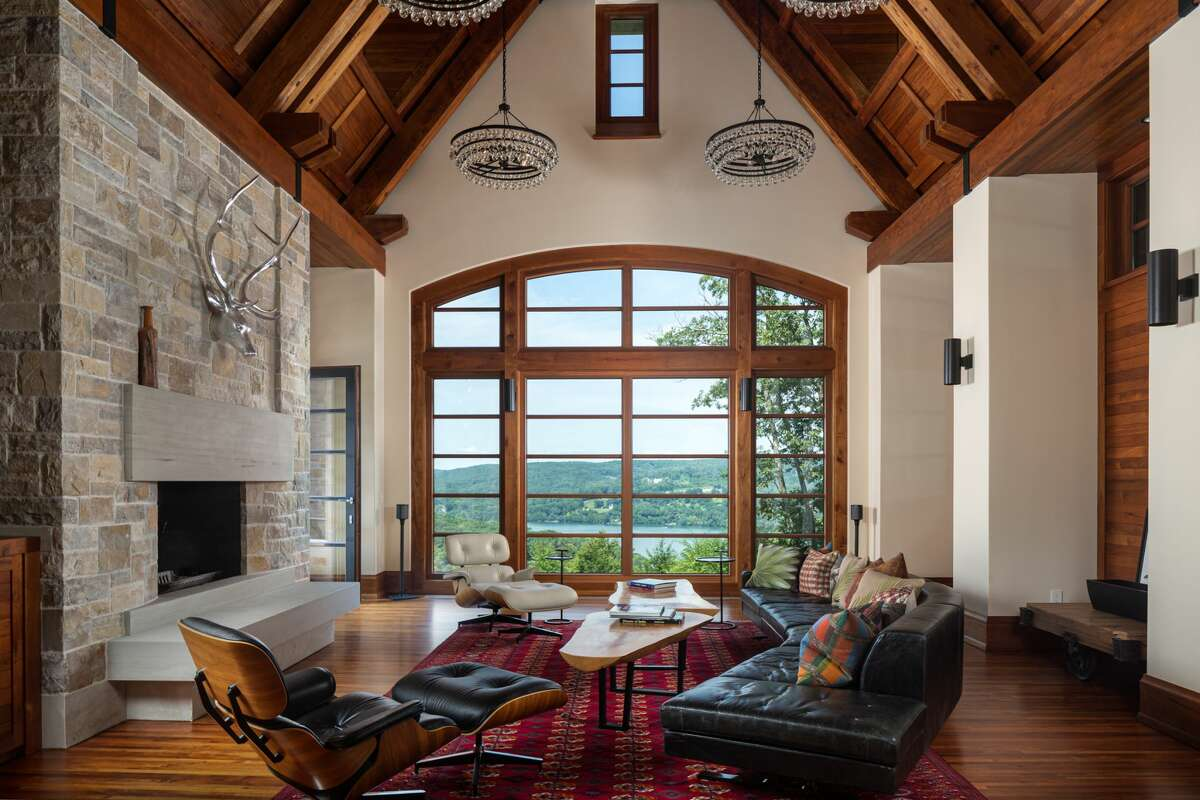 The home on 46 June Road in Washington, Conn. has a great room with vaulted ceilings and a wall of windows.