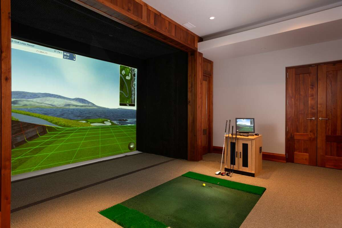 The home on 46 June Road in Washington, Conn. has a room dedicated to a Full Swing golf simulator.
