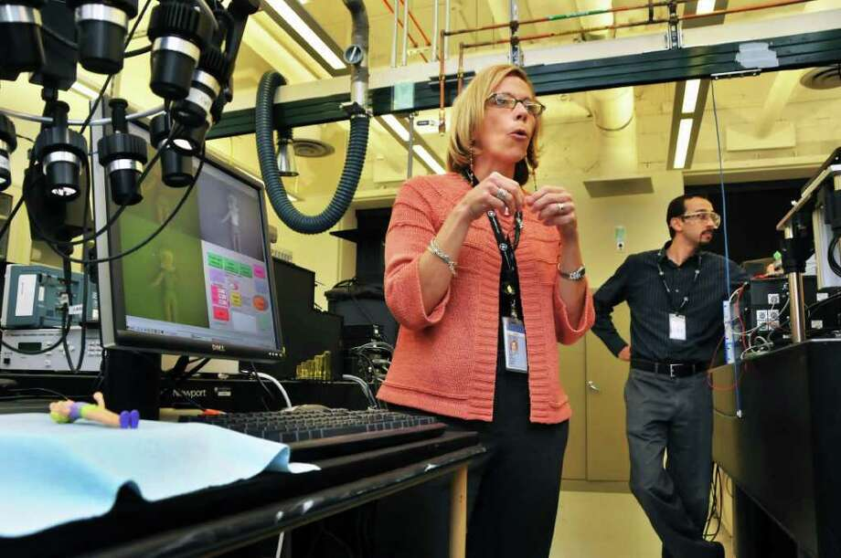 Kathleen Bove,  manager of Biomedical Imaging & Physiology, and senior scientist Siavasa Yazdanfar (at right) during a tour of the optical imaging lab at GE Global Research Center in Niskayuna Wednesday afternoon September 15, 2010.  (John Carl D'Annibale / Times Union) Photo: John Carl D'Annibale / 00010194A