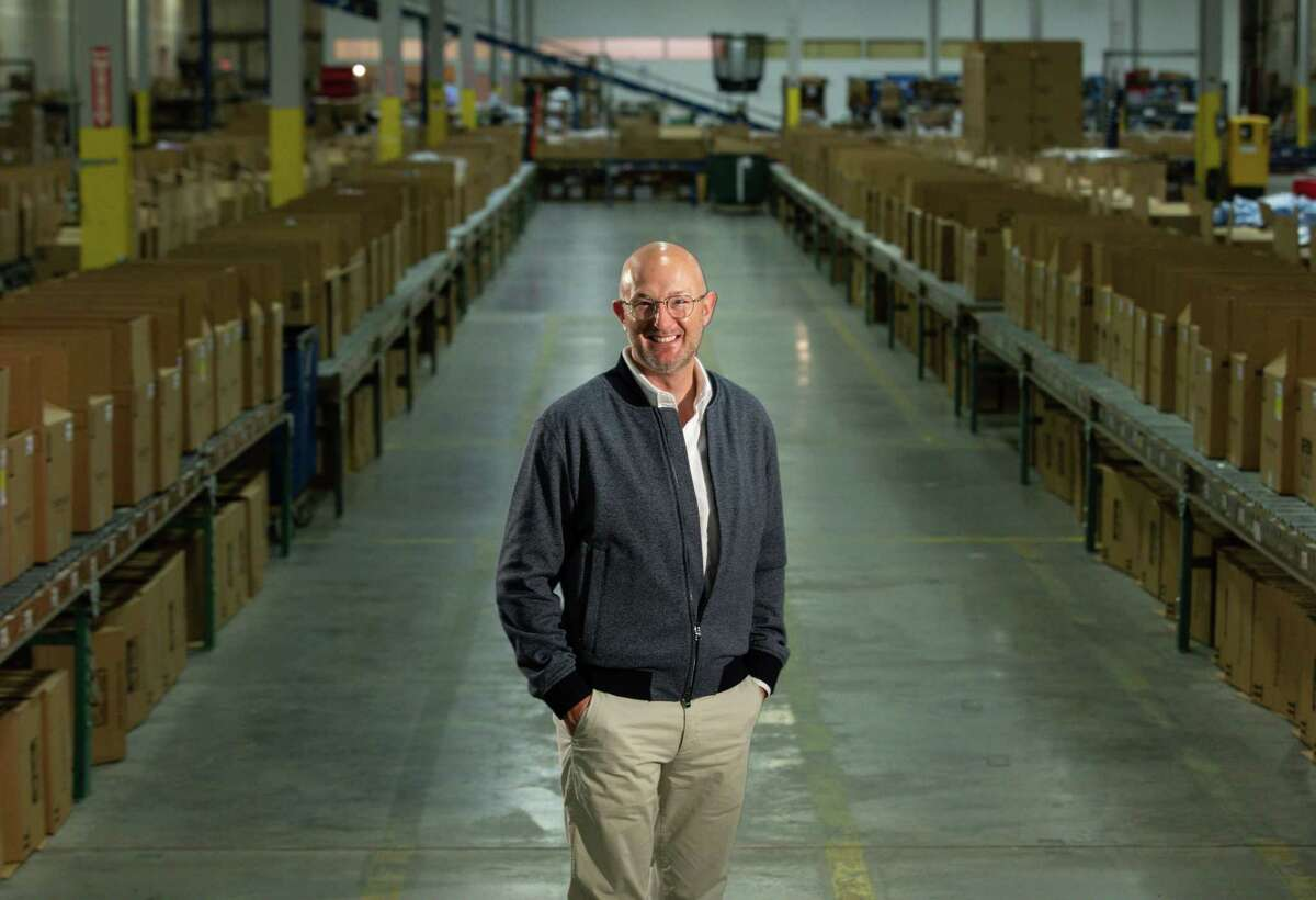 Andrew Clarke, CEO of Francesca's, poses for a portrait Wednesday, Aug. 4, 2021, at the company's warehouse in Houston.