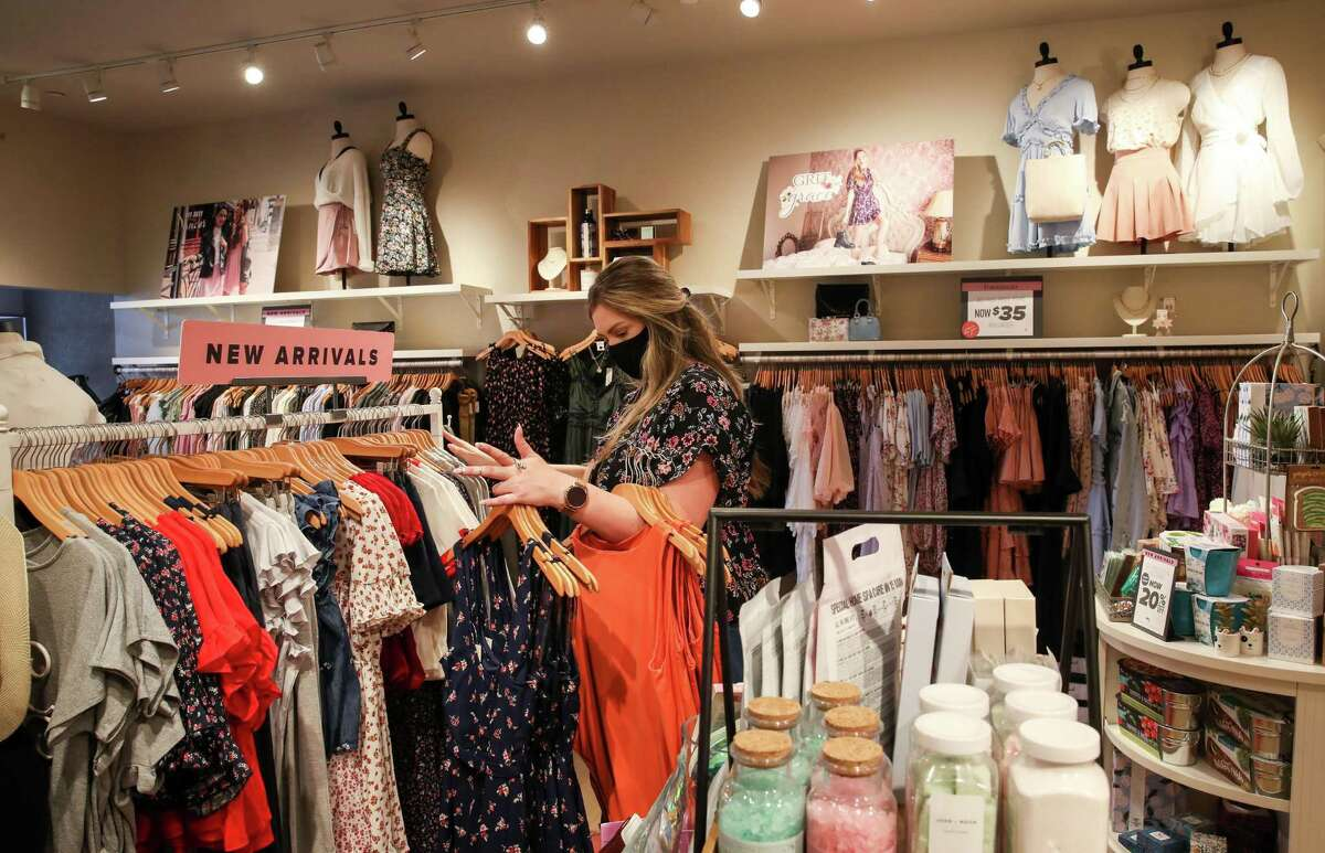 Meghan Leaverton, a boutique team leader, or manager, arranges her store Wednesday, Aug. 4, 2021, at a Francesca's location in Houston.