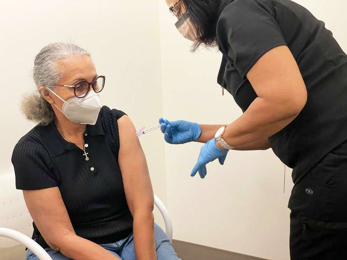 Community Heath Center medical personnel administer a COVID-19 vaccine to a patient in Middletown.