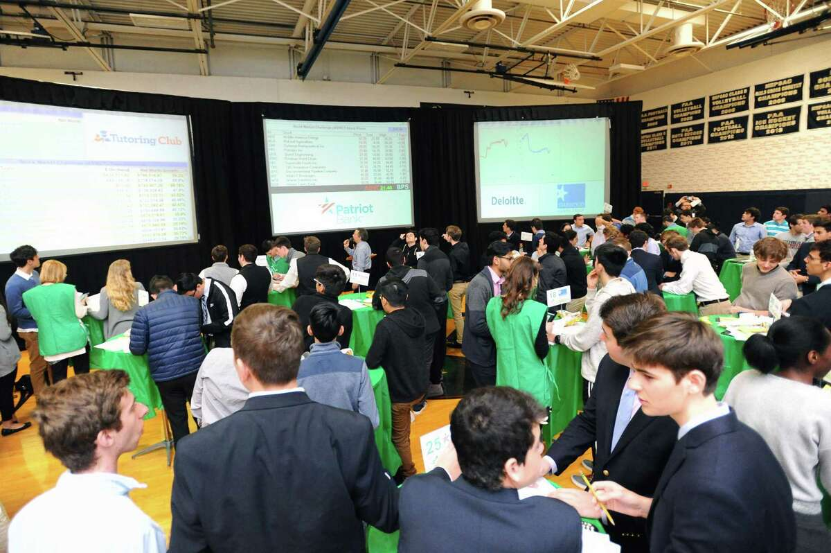 Students from seven high school compete in the Junior Achievement Student Stock Market Exchange Challenge inside King School's gymnasium in Stamford in 2018.