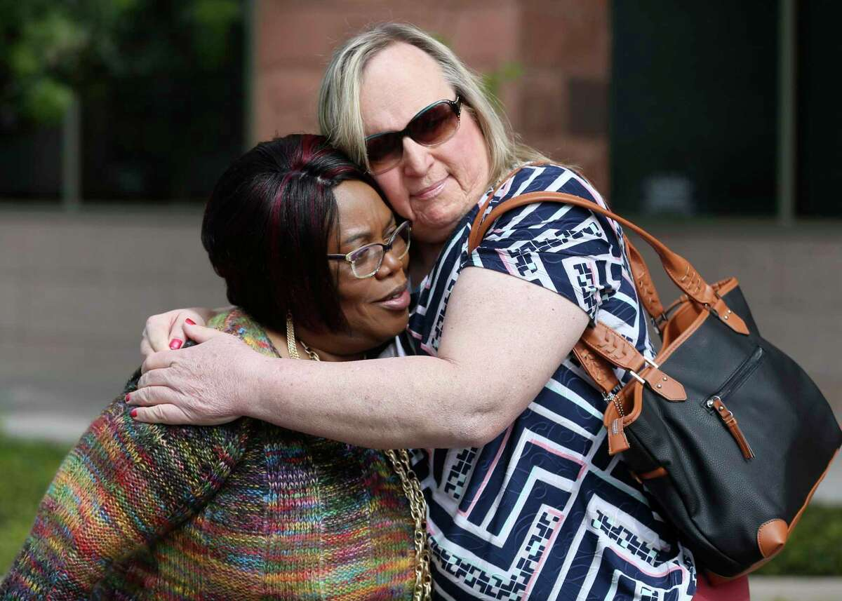 Joann McFadden, left, is hugged outside the Bexar County Criminal Justice Center by Lauryn Farris before a March 2018 news conference by LGBTQ community members to denounce the handling of Kenne McFadden's case by the district Attorney's office. McFadden is the mother of Kenne McFadden, a transgender woman who was allegedly killed by Mark Lewis. Lewis can not be prosecuted for the alleged crime after prosecutors failed to convince a judge the incident was grounds to revoke Lewis's parole.