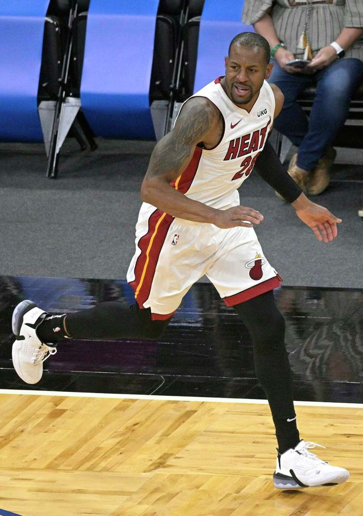 Miami Heat forward Andre Iguodala (28) celebrates after scoring a 3-point basket during the second half of an NBA basketball game against the Orlando Magic on Sunday, March 14, 2021, in Orlando, Fla. (AP Photo/Phelan M. Ebenhack)
