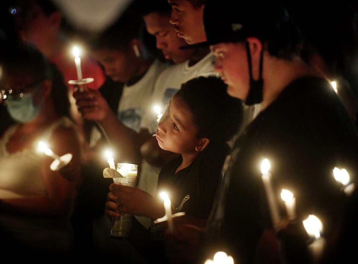 Friends and family of deceased 14-year-old budding football star Zyon McDuffie hold a candlelight vigil in his honor at Longbrook Park in Stratford, Conn. on Thursday, August 5, 2021.