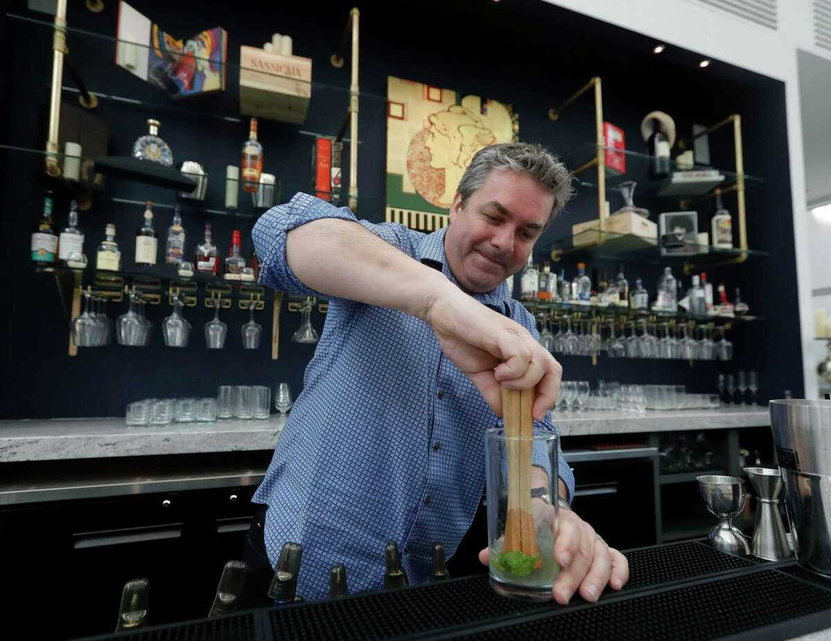 Dragos Tapu makes a mojito at The Glade Cultural Center's new bar, Thursday, July 29, 2021, in The Woodlands. The non-profit added the bar to complement the gallery's exhibition space showcasing local and international artist.