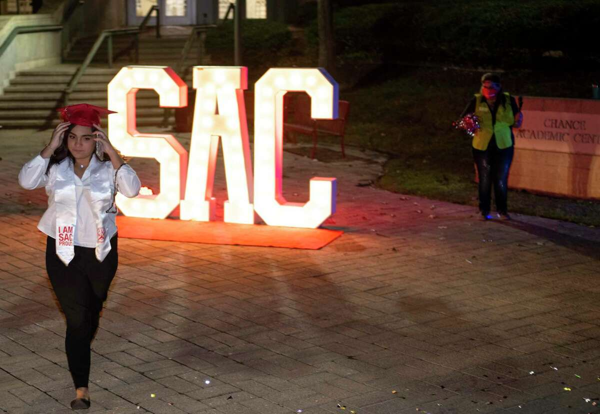 A student celebrates graduating from San Antonio College in 2020. Community colleges can now offer more four-year degrees, offering brighter futures and boosting the economy.