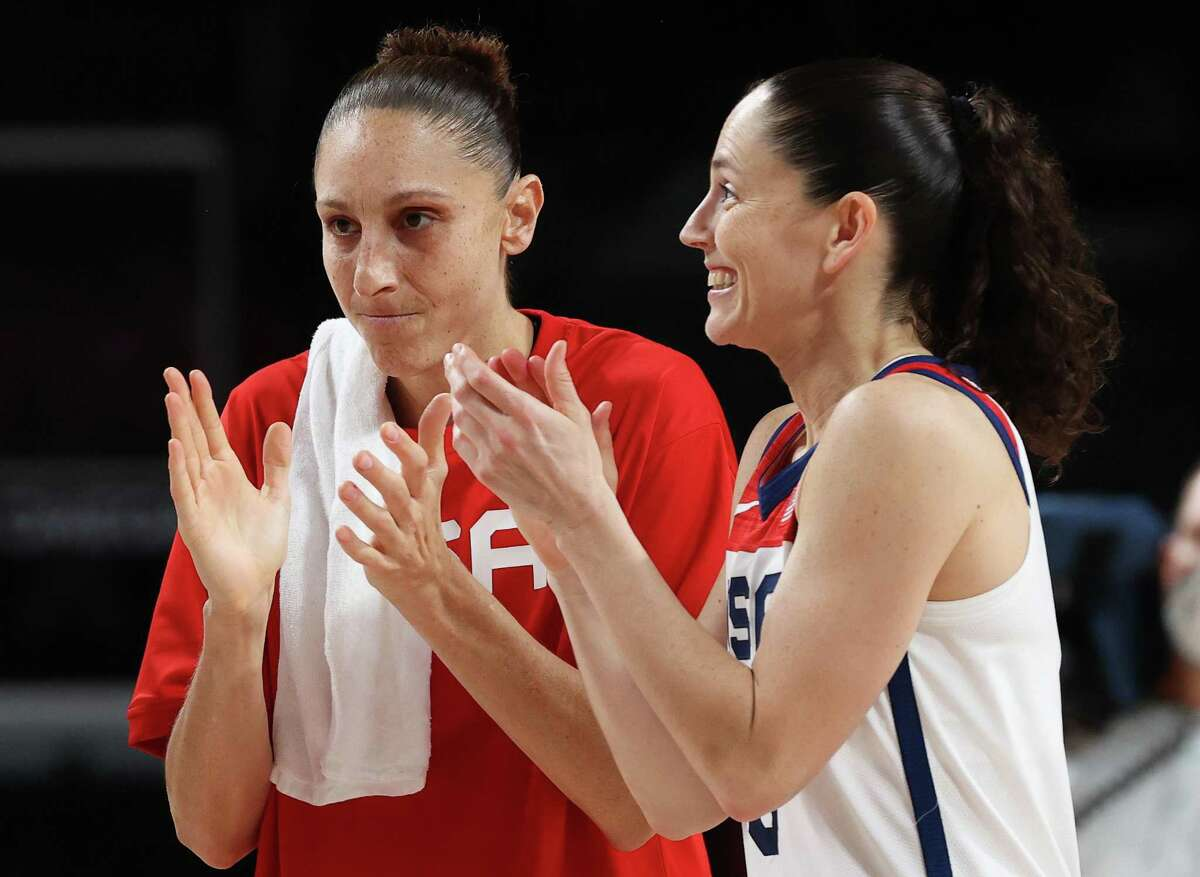 Diana Taurasi, left, and Sue Bird of Team USA celebrate their win over Serbia in a women's basketball semifinal game on day 143 of the Tokyo 2020 Olympic Games at Saitama Super Arena on August 6, 2021.