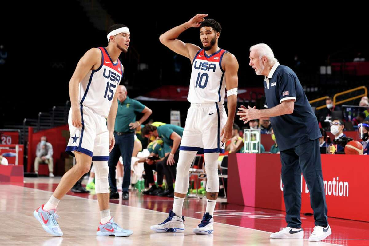 Team USA oach Gregg Popovich talks strategy with Devin Booker (15) and Jayson Tatum during the first half of a men's basketball semifinal game on day 13 of the Tokyo 2020 Olympic Games at Saitama Super Arena on Aug. 5, 2021 in Saitama, Japan.
