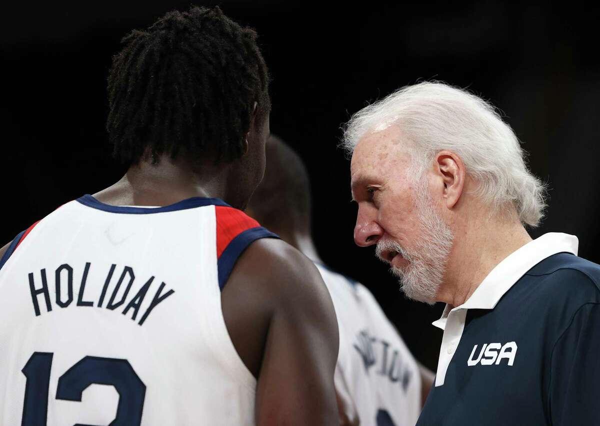 Coach Gregg Popovich speaks with Jrue Holiday during the second half against Australia at Saitama Super Arena on August 05, 2021 in Saitama, Japan.