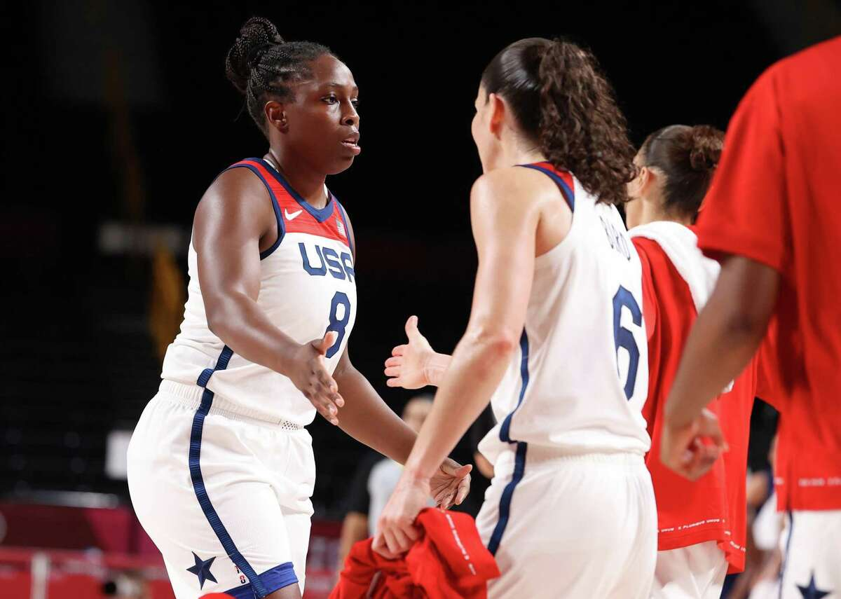 SAITAMA, JAPAN - AUGUST 06: Chelsea Gray #8 of Team United States high-fives teammate Sue Bird #6 during the first half of a Women's Basketball Semifinals game on day fourteen of the Tokyo 2020 Olympic Games at Saitama Super Arena on August 06, 2021 in Saitama, Japan. (Photo by Gregory Shamus/Getty Images)