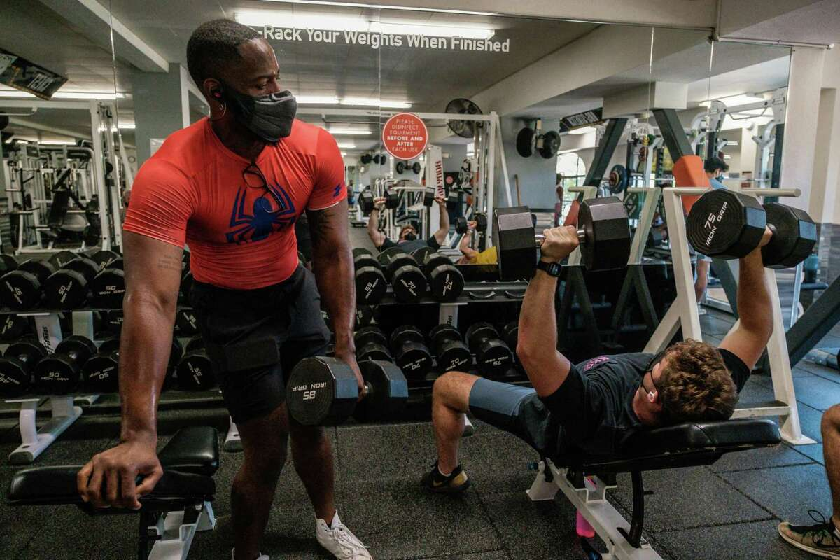 JR Miller works out at a gym in Oakland. Miller said he's lived a pretty basic life during the pandemic, which is why he was surprised to have had a breakthrough COVID infection.