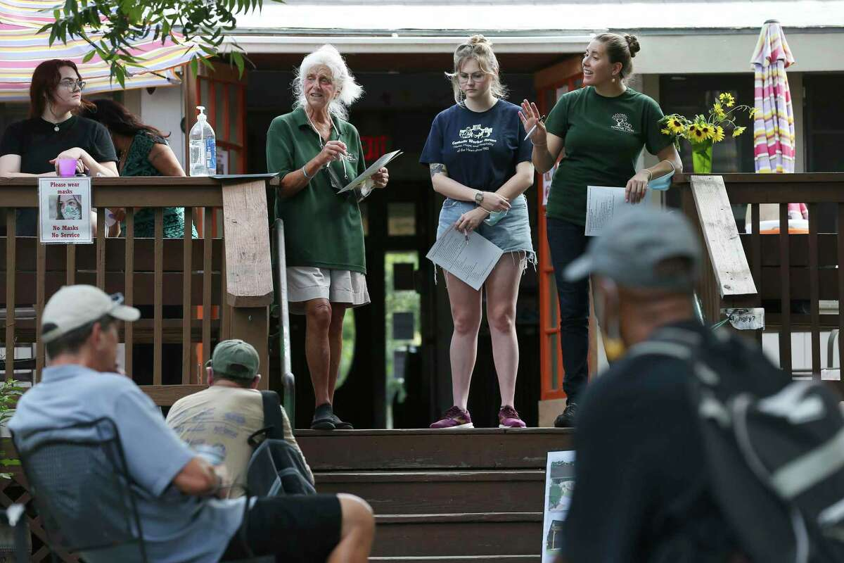 Catholic Worker House Manager Dr. Chris Plauche, second from left, is joined by, from left, Faith Fisher, Claudia Pharr and Tia Moen, during a town hall meeting on Friday, July 2, 2021.