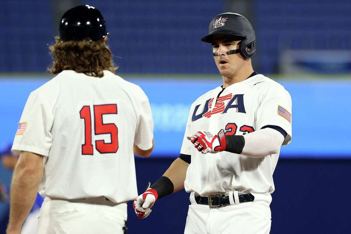 YOKOHAMA, JAPAN - AUGUST 05: Tyler Austin #23 of Team United States fist bumps Scott Kazmir #15 after hitting a two RBI single in the sixth inning against Team Republic of Korea during the semifinals of the men's baseball on day thirteen of the Tokyo 2020 Olympic Games at Yokohama Baseball Stadium on August 05, 2021 in Yokohama, Japan. (Photo by Koji Watanabe/Getty Images)