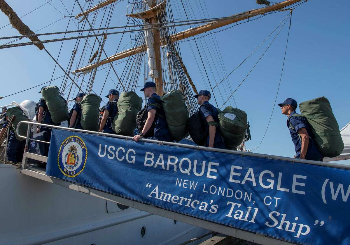 Coast Guard Academy cadets board the USCG Barque Eagle. You can bet the kids balancing on ropes high above the waves aren't paralyzed by partisan politics.