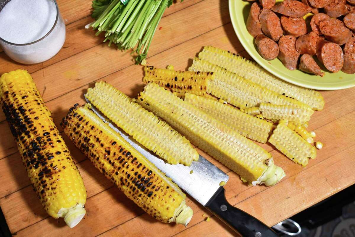 Charred corn is a key ingredient to a chunky and warming soup with chorizo and herbs.