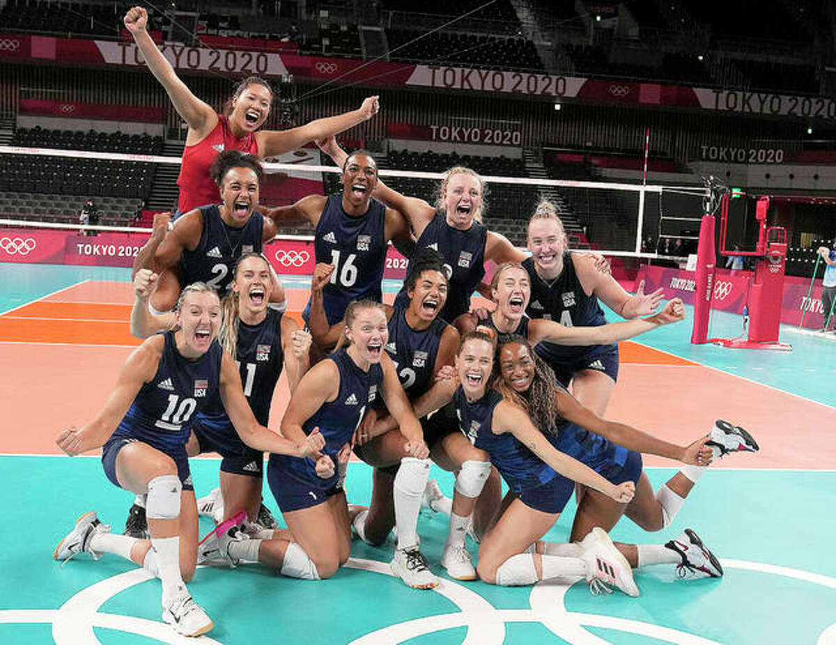 United States players celebrate winning the women's volleyball semifinal match against Serbia Friday at the Tokyo Summer Olympics. Collinsville High grad Michelle Bartsch-Hackley is far right in the back row.