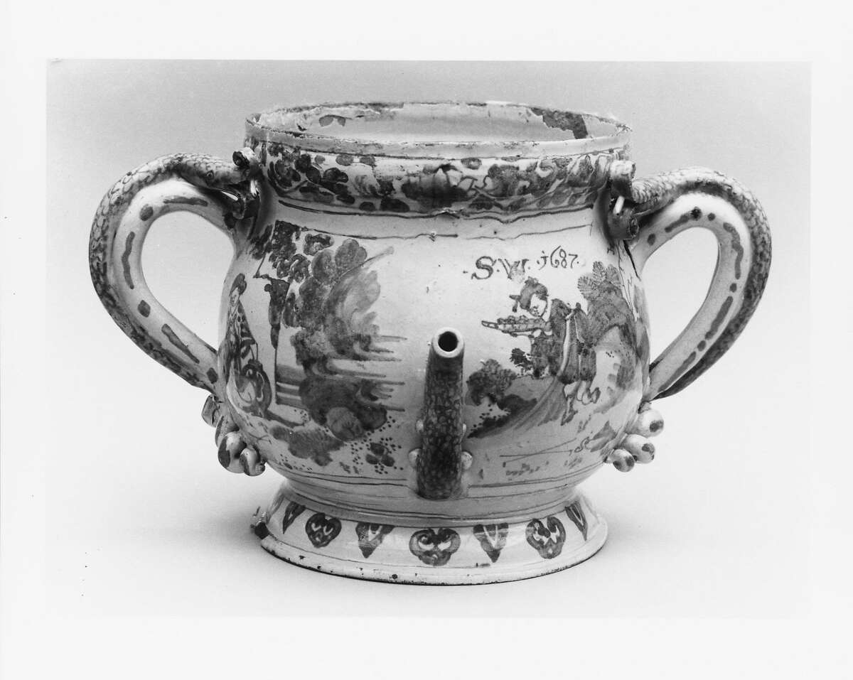 A posset pot made by Lambeth Factories in England in 1687. The spout enabled people to drink the liquid at the bottom before eating the curds with a spoon after.