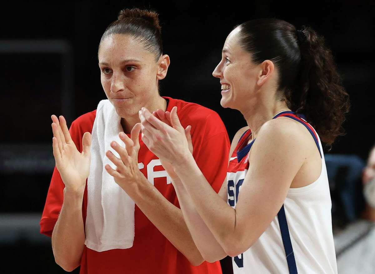 SAITAMA, JAPAN - AUGUST 06: Diana Taurasi #12 and Sue Bird #6 of Team United States celebrate their win over Serbia in a Women's Basketball Semifinals game on day fourteen of the Tokyo 2020 Olympic Games at Saitama Super Arena on August 06, 2021 in Saitama, Japan. (Photo by Kevin C. Cox/Getty Images)