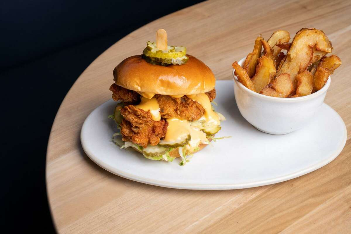 The fried chicken sandwich with aleppo mayo and salt-roasted fries at Roger Bar and Restaurant in Mountain View.