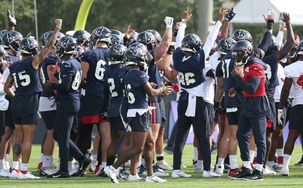 Houston Texans player gather in a huddle to start practice during an NFL training camp football practice Friday, Aug. 6, 2021, in Houston.