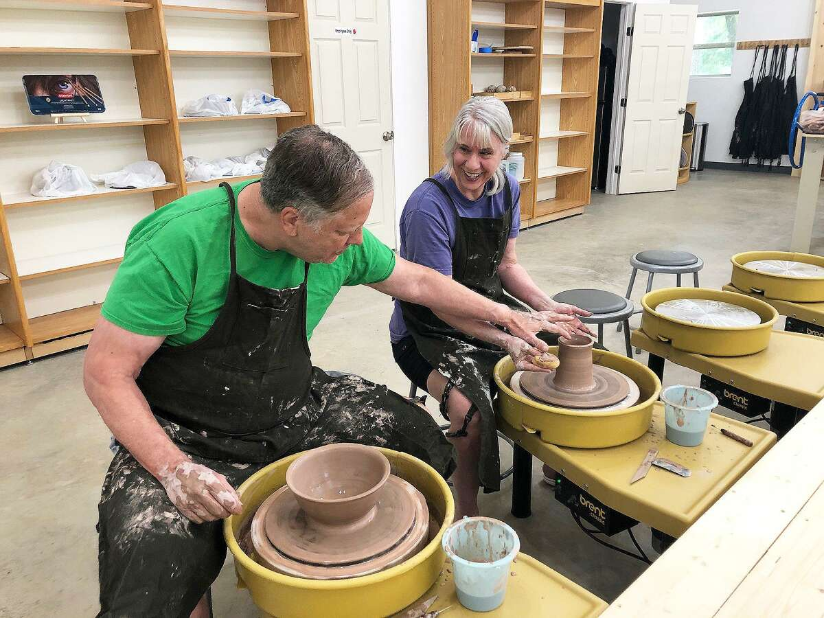 David and Susan Simmons enjoy working together on the ceramic wheels next to each other as they create different projects at Woodland Lane Ceramics and Art Studio in Magnolia.