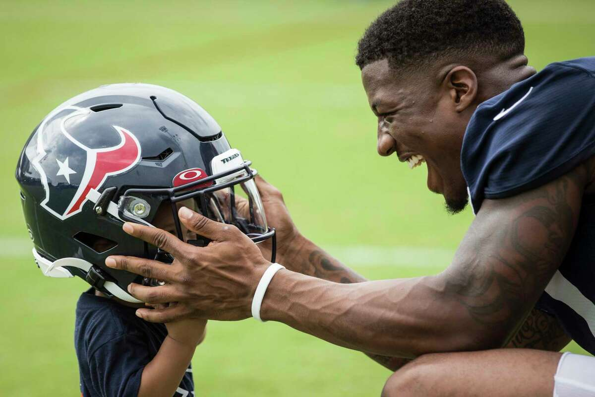 New Texan Anthony Miller, playing with son Anthony II after practice Friday, is battling Keke Coutee and Alex Erickson for the starting job at slot receiver.