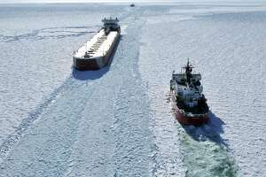 The U. S. Coast Guard cutter Mackinaw, right, works in thick ice to break out the freighter Edwin Gott in Whitefish Bay of Lake Superior, Friday, March 27, 2015. Approximately 90 Midwestern shipping organizations, suppliers and ports are supporting the Great Lakes Winter Commerce Act, which would put aside funding for a second Great Lakes icebreaker, on par with the Mackinaw Icebreaker. (AP Photo/John L. Russell)