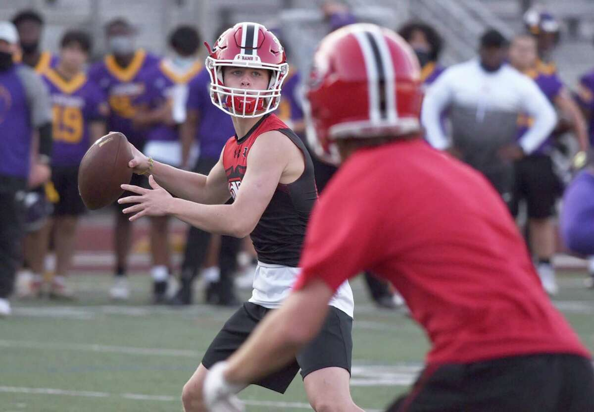 New Canaan's Henry Cunney eyes a receiver downfield during the Rams' 7-on-7 football game at Westhill on Friday, Oct. 9, 2020.