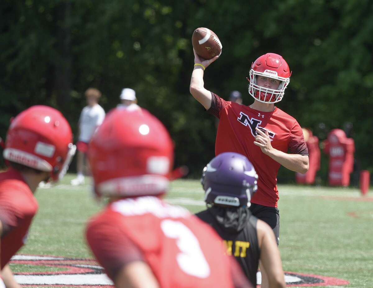New Canaan quarterback Henry Cunney throws a pass downfield during day one of the Grip It and Rip It football tournament in New Canaan on Friday, July 9, 2021.
