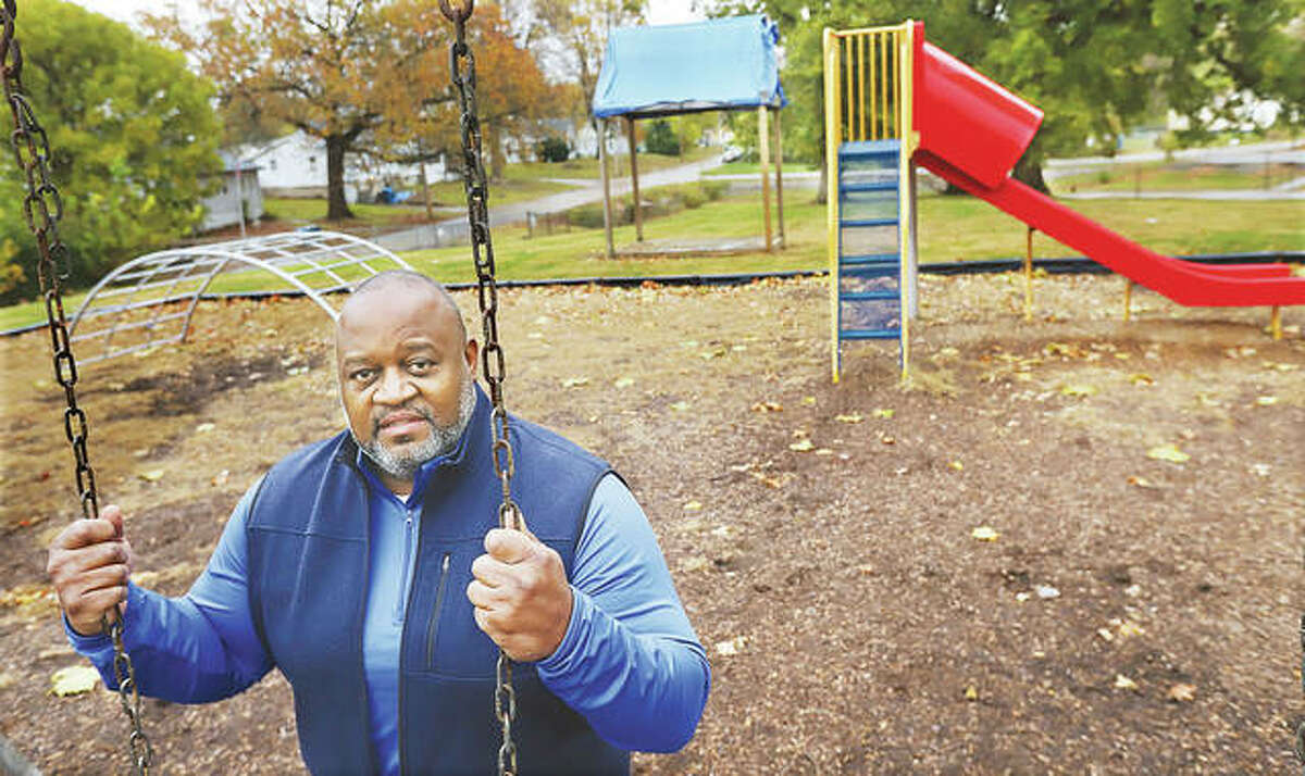 Al Womack is shown last fall with the current playground equipment. The club set a goal of $100,000 to replace the aged equipment and, to date, has received donations of more than $118,000. - John Badman|The Telegraph