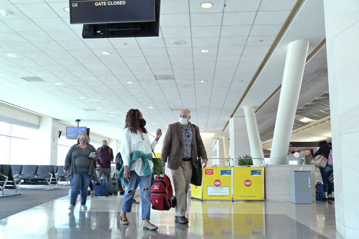 Air travelers are seen arriving at San Francisco International Airport on Oct. 27, 2020, in San Francisco.