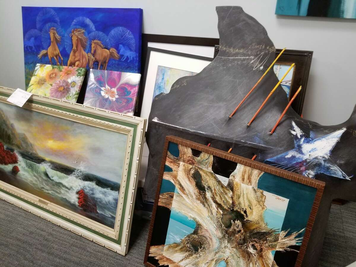 Although an art gallery in League City's civic center hasn't opened yet, the office of Sarah Greer Osborne, the city's communications director, has become a repository for local artists' work.