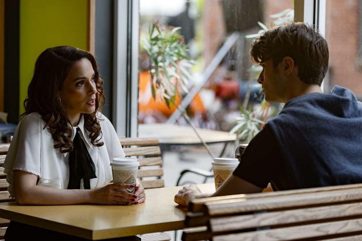 Actress Christina DeRosa and actor Alec Nevin shoot a scene for an upcoming Liftime move inside Brew Bakers in Middletown Thursday.