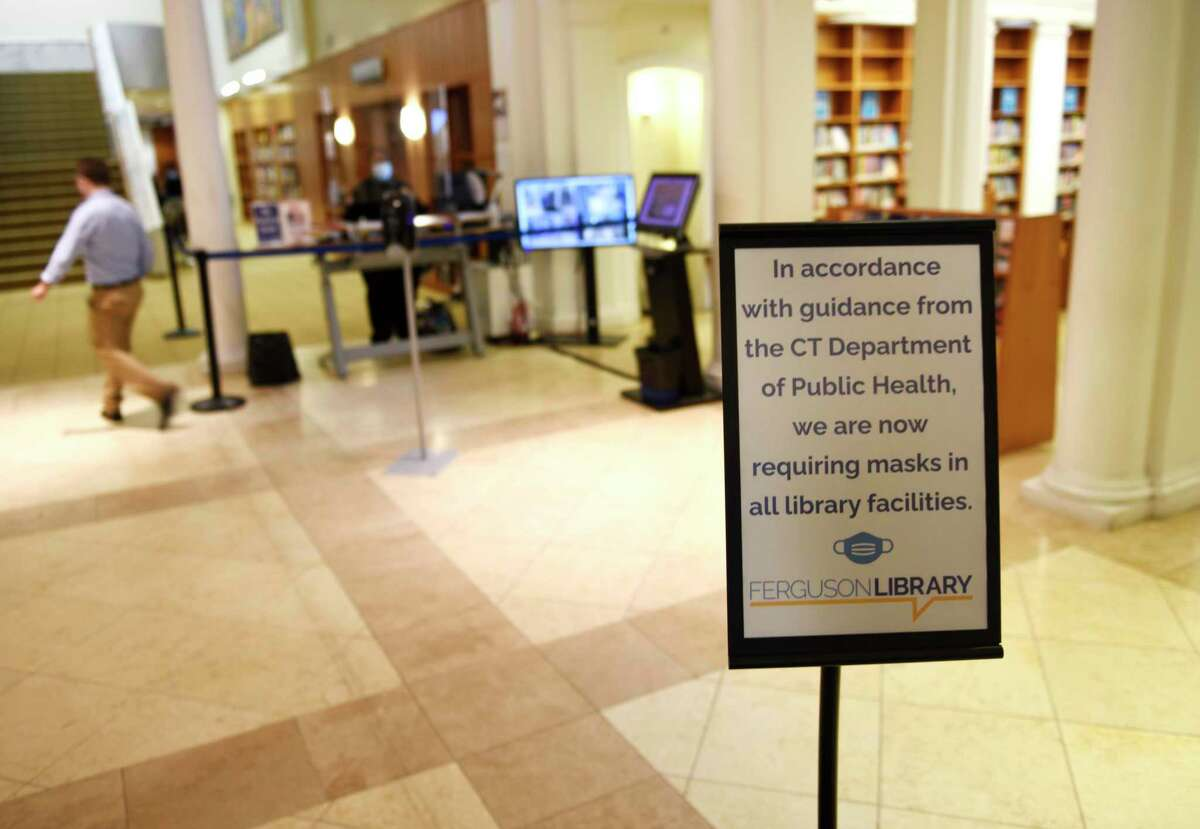 A sign requires guests to wear masks at the Ferguson Library in Stamford, Conn. Wednesday, Aug. 4, 2021. COVID cases are on the rise again and the state Department of Health has recommended that anyone over the age of 2 wear a mask indoors regardless of vaccination status.