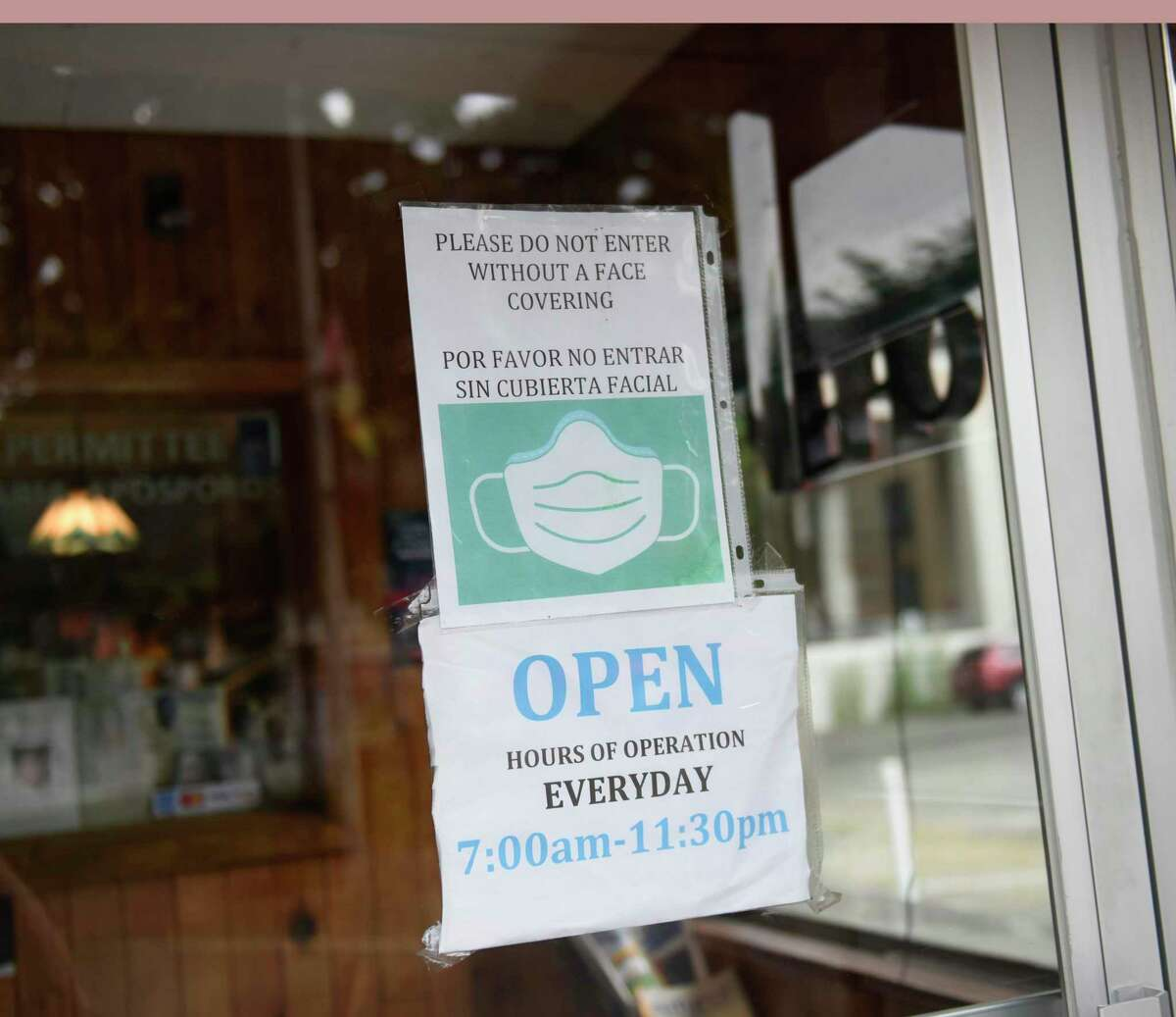 A sign requires face masks at Curly's Diner in Stamford, Conn. Wednesday, Aug. 4, 2021. COVID cases are on the rise again and the state Department of Health has recommended that anyone over the age of 2 wear a mask indoors regardless of vaccination status.