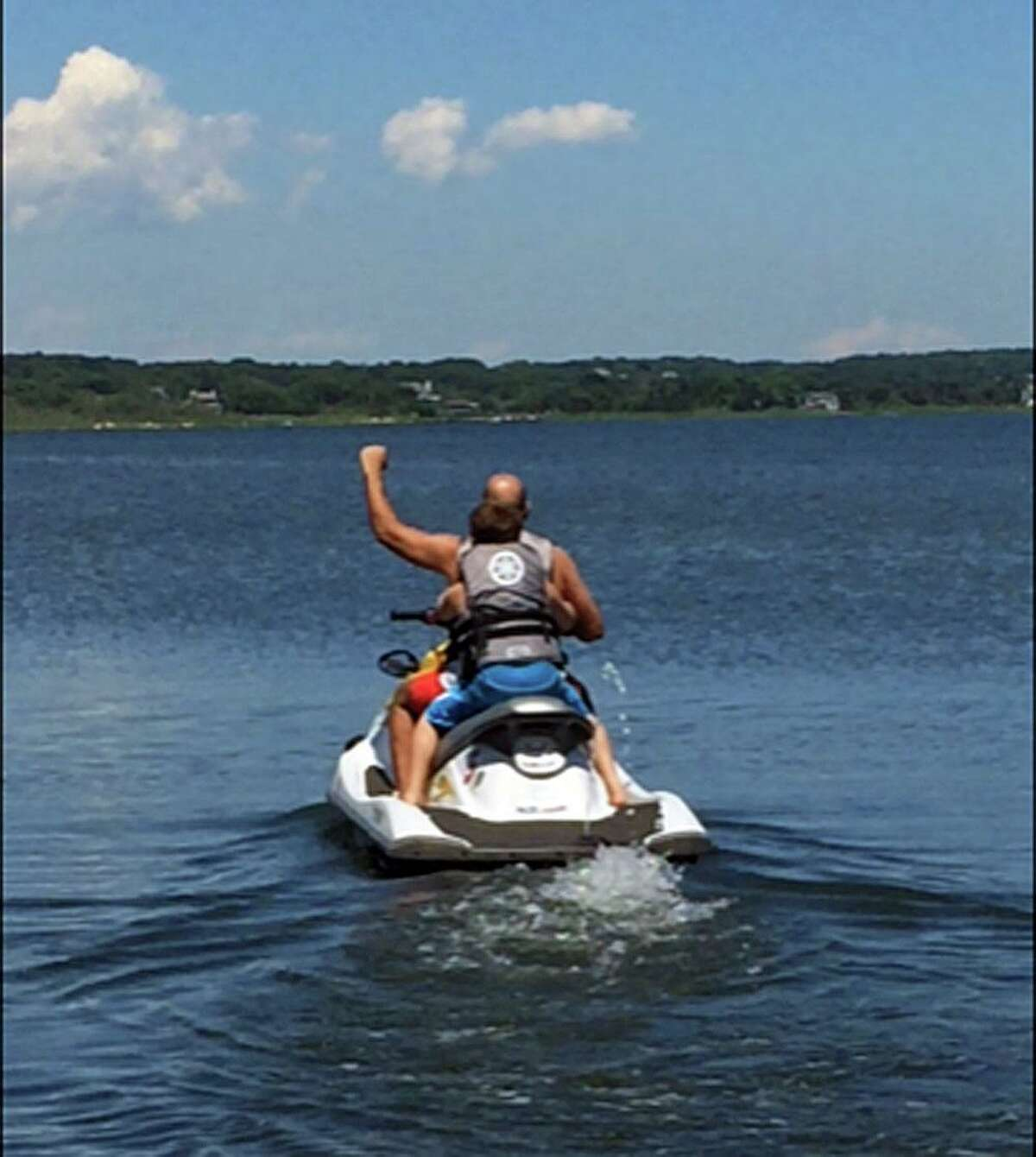 Vinnie Penn on jet skis with his son.